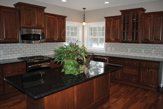 Fascinating Idea Of Black Pearl Granite Countertops And White Glass Tile  Backsplash Connected By Dark Brown Kitchen Cabinet