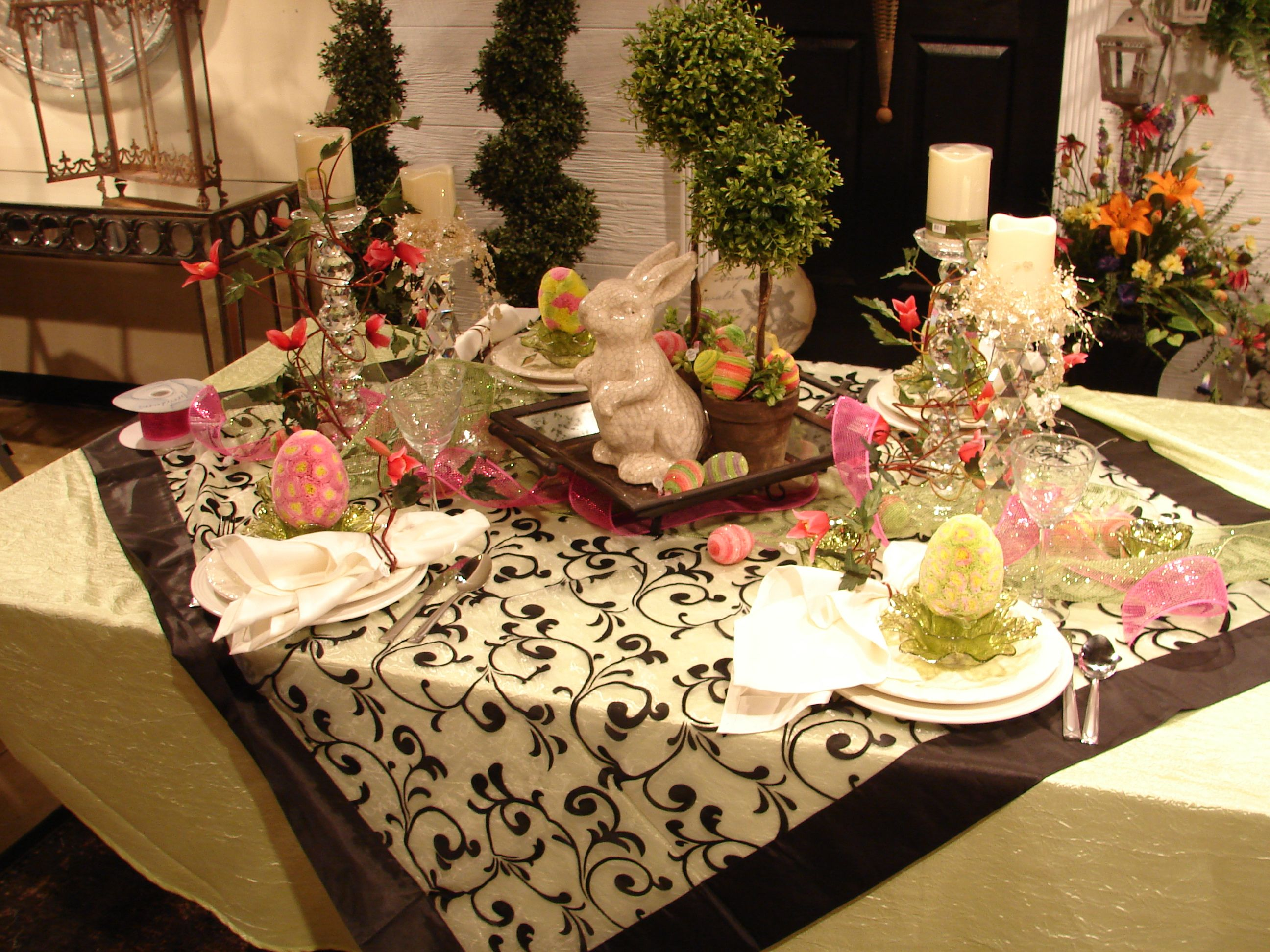 #Easter table setting, place a square table cloth on bigger rectangular table, lots of eggs, rabbits and topiaries...ribbon many elements going on but very nice  visit me at My Personal blog: http://stampingwithbibiana.blogspot.com/