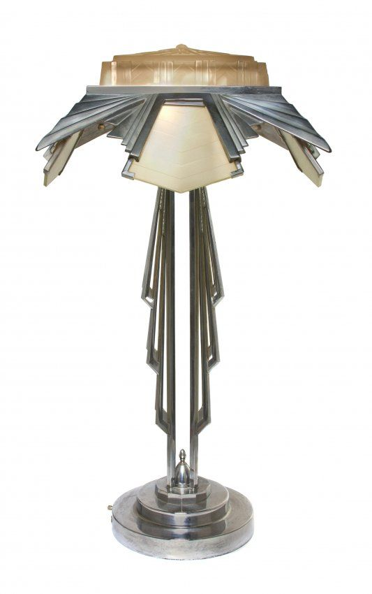 An art deco style chrome and molded glass table lamp the diffusers and stem w geometric decoration raised on a stepped base