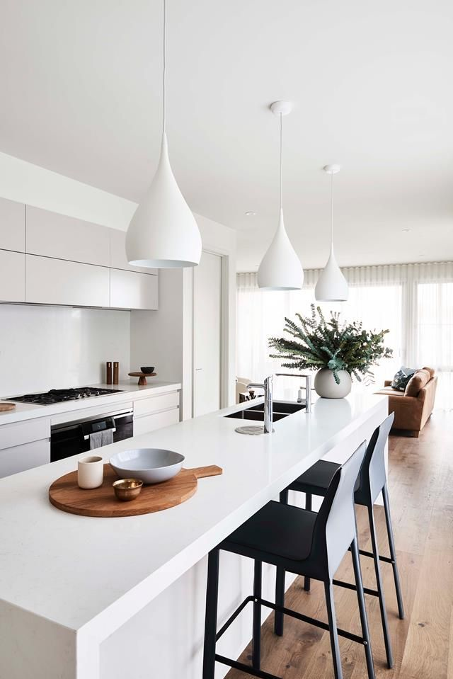 The kitchens in the townhouses designed by Mirvac at Tullamore feature Spinning pendant lights by Benjamin Hubert from Great Dane Premium Miele appliances and a Zip Hydro...
