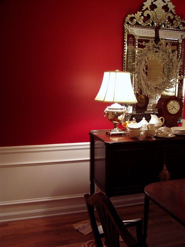 A Red Georgian Dining Room With White Mouldings