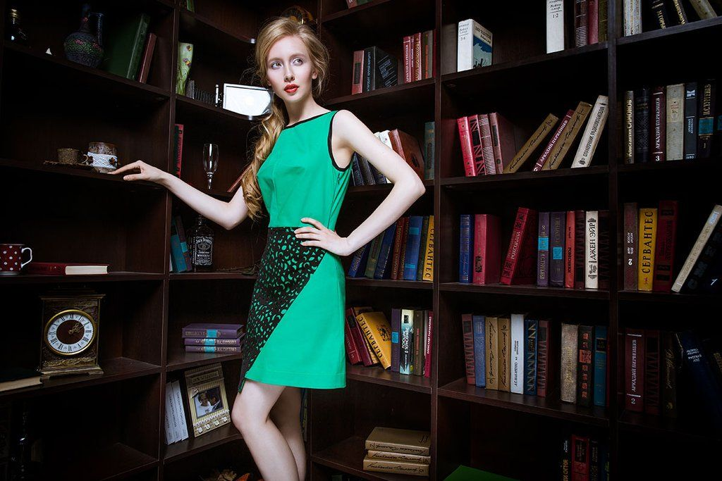 Style NotesAll day wear dress. Slim-waisted green sleeveless dress of classical cut. The most attractive feature of the dress is black perforated fabric on the