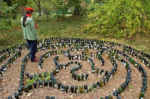 labyrinth garden design. Labyrinth made of glass bottles inverted and placed into the ground  An unusual design too