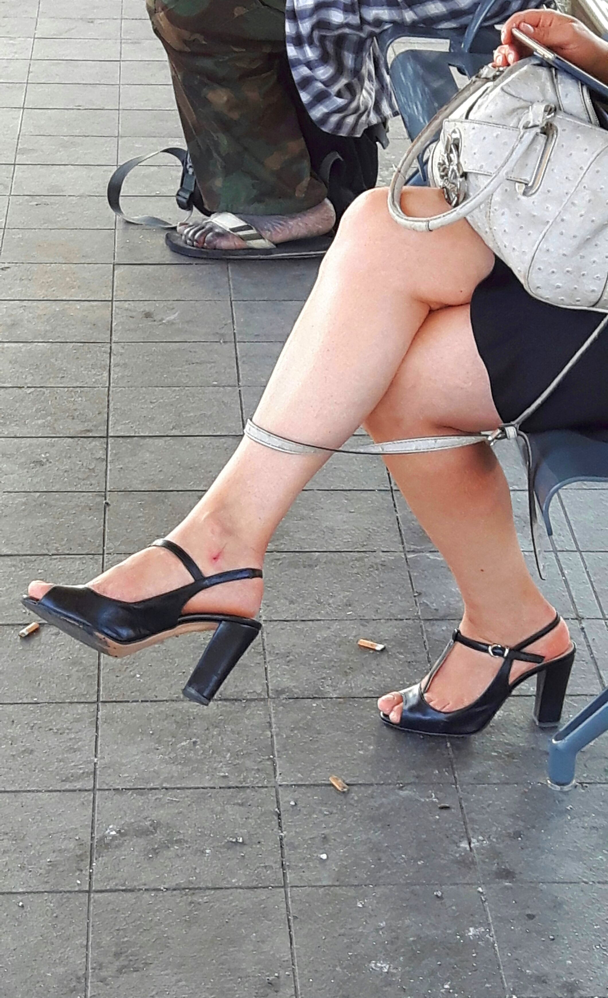 Candid crossed legs