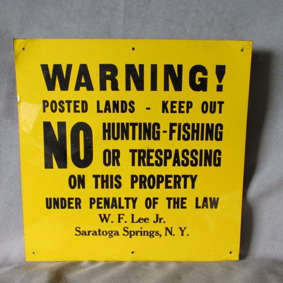 A neat vintage tin sign. The sign is marked  WARNING! Posted Lands- Keep Out, NO Hunting, Fishing or Trespassing on this Property Under