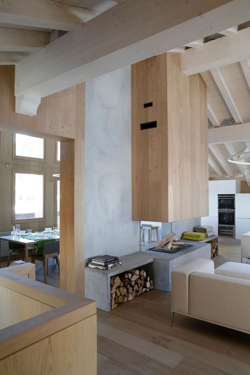 Exposed concrete and wood shape the simple and minimal interior