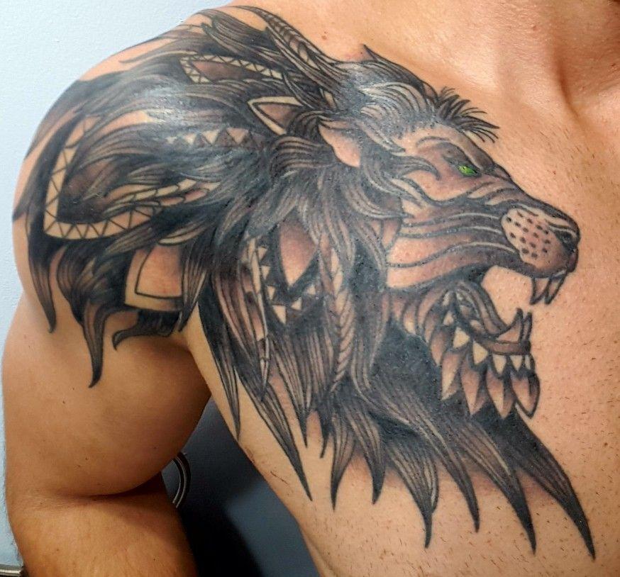 Chest Tribal Lion Tattoo Designs For Men