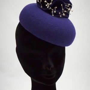 Veronica Pill Box Hat - Rich purple wool with abstract purple flower with gold tone stamen.