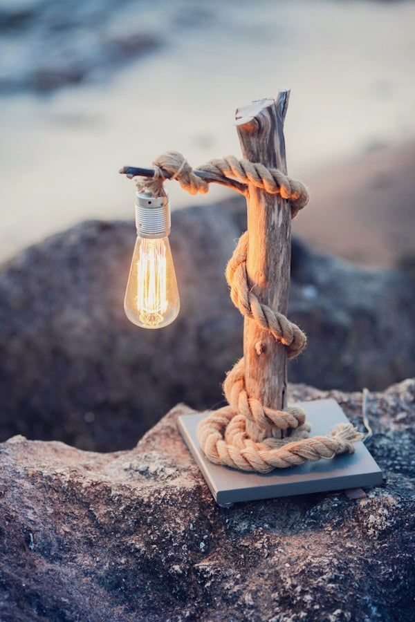 Driftwood lamp with rope.