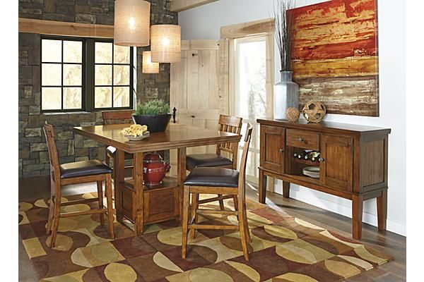 The Ralene Counter Height Extension Dining Room Table from Ashley