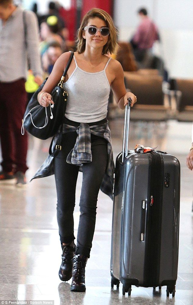 1f01aa1f898ac Braless Sarah Hyland shows off casual style as she flies into Canada