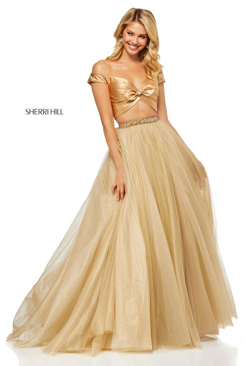 99d042f63b Style 52406 from Sherri Hill is an off the shoulder two piece prom gown  with a tie front crop top and a sparkling full skirt.