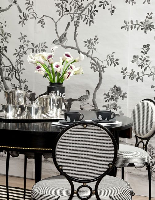 Hand Painted Wallpaper by Fromental, Rene Drouet Chairs,Black Lacquered Demi-Lune Table Attributed to Jansen, Belted Stripe Rug, andSilver Coffee and Tea Set. Design by Celerie Kemble. Photo by Hulya Kolabas.