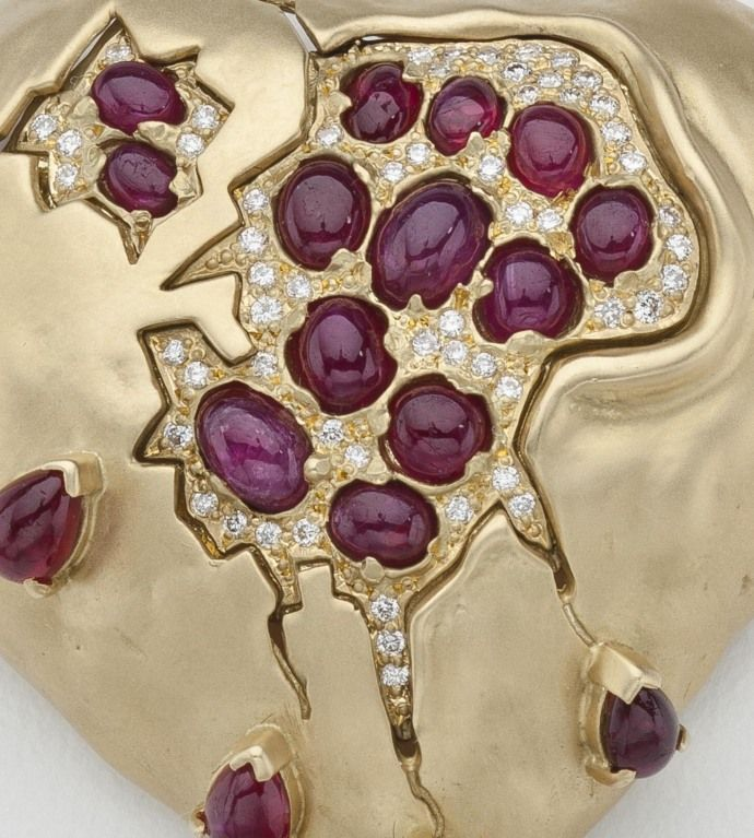 """Description from 1stdibs: """"The """"Pomegranate Heart"""" was designed by Dali in the 1950's with rubies and diamonds. This example was fabricated by Henryk Kaston who made all of Dali's jewelry from 1980 to 1990. The stones include 17 pear shaped and oval cabochon cut rubies, for a total weight of 6.44 carats. The brooch is further highlighted by 63 full cut round diamonds for a total weight of .63 carats. The brooch is signed Dali by Kaston."""" 1stdibs.com"""