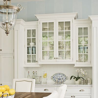 Glass front kitchen cabinets in the breakfast room  Elegant Kitchen Kitchens Blue ceilings and doors