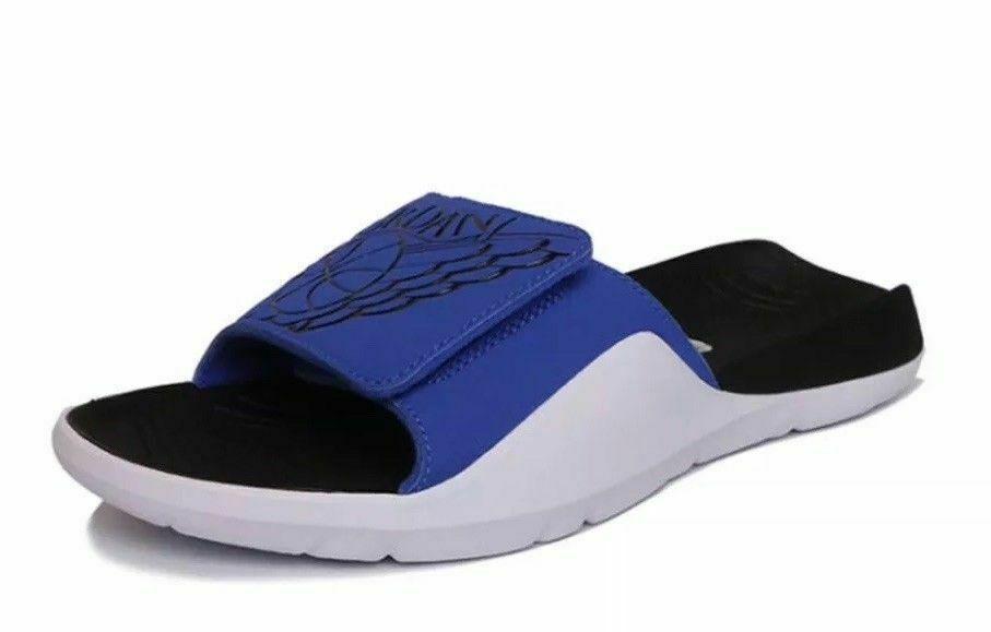 blue and white jordan slides