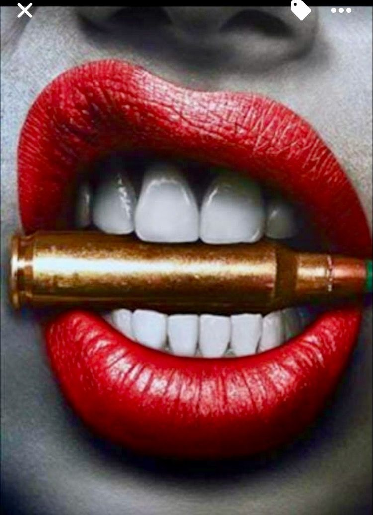 Red Lips And Teeth Clenching A Gold Bullet Lip Art