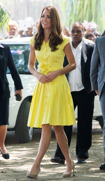 d1c5b32c7c Kate wearing a casual yellow cotton dress by Jaeger with a flared pleated  skirt at the craft fair on tour.