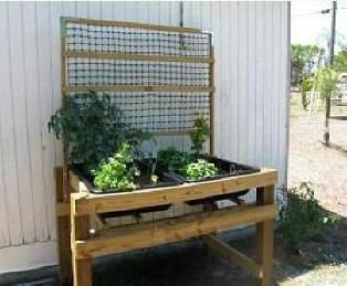 Waist high raised bed gardening system