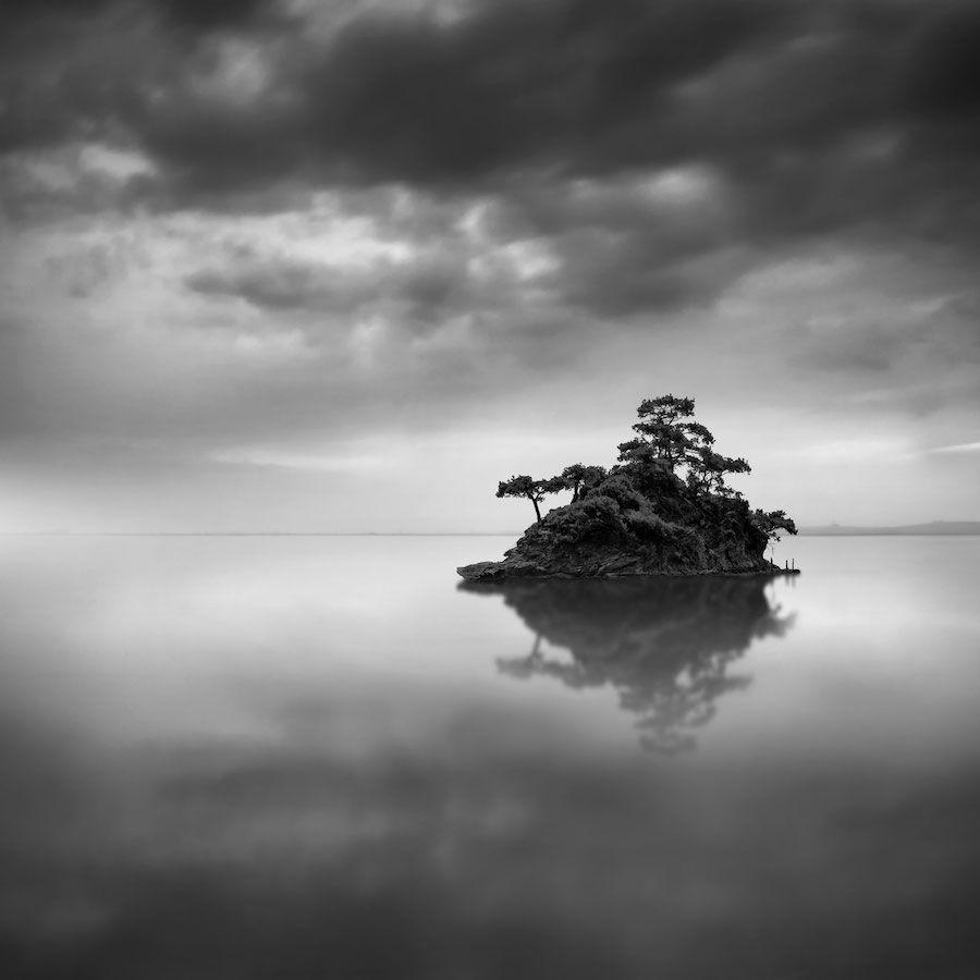 Minimalist photographer captures dramatic depth of nature in black