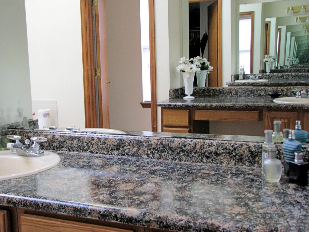 Painted countertops.....I wonder if I can convince my landlord to do this to the baby blue bathroom countertop (circa 1970).        http://designergarden.blogspot.com/2012/03/giani-granite-review.html