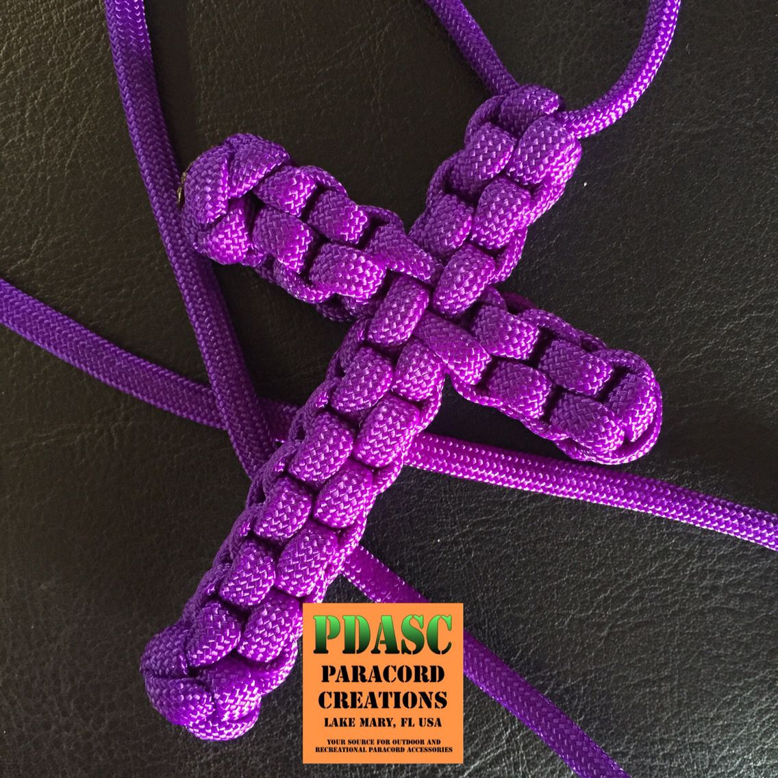 Purple Cross from today's market event. Lady picked this up for a family member along with a Blue Awareness Ribbon. ••• Color: Acid Purple #PDASC #Paracord #cross