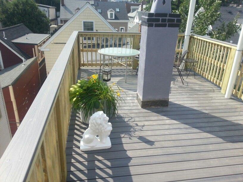 Composite decking, pressure treated railings with a ...