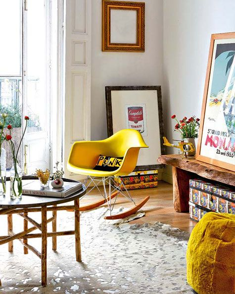 Yellow Eames Rocking Arm Chair and a nice Wood Bench.