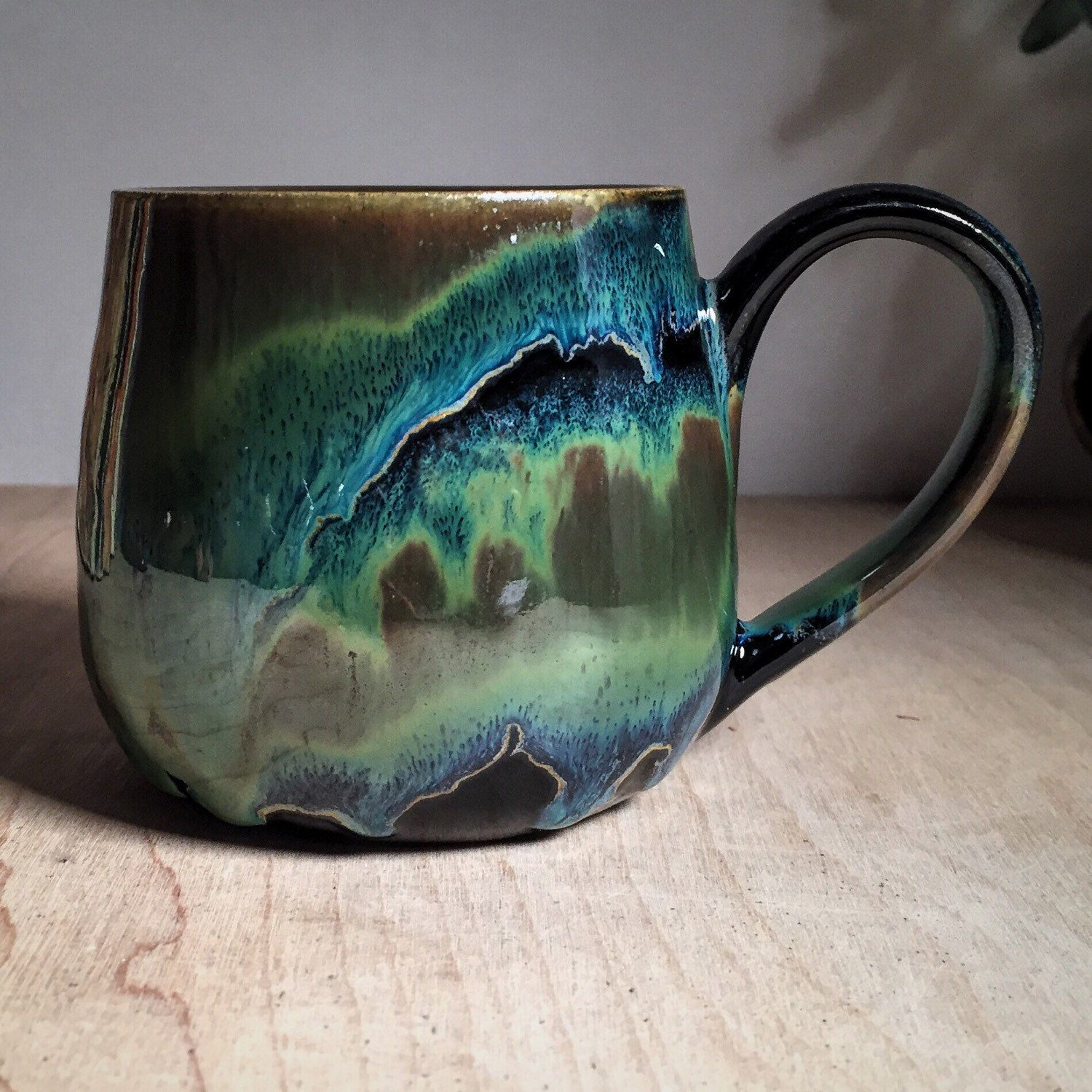 Bands of Obsidian and Seaweed on buff stoneware fired to cone 6 by Amanda Joy Wells