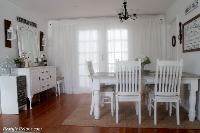Photo of Rustic Farmhouse Dining Room in Love Note White and a Chandelier Makeover