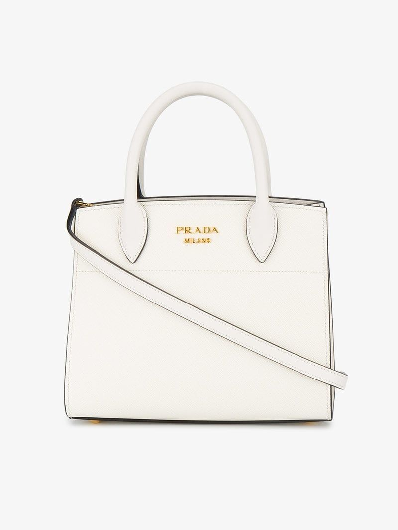 628f3e977c13 PRADA | White Bibliotheque Mini Tote Bag | $3,060 | This white Prada ' Bibliothèque'
