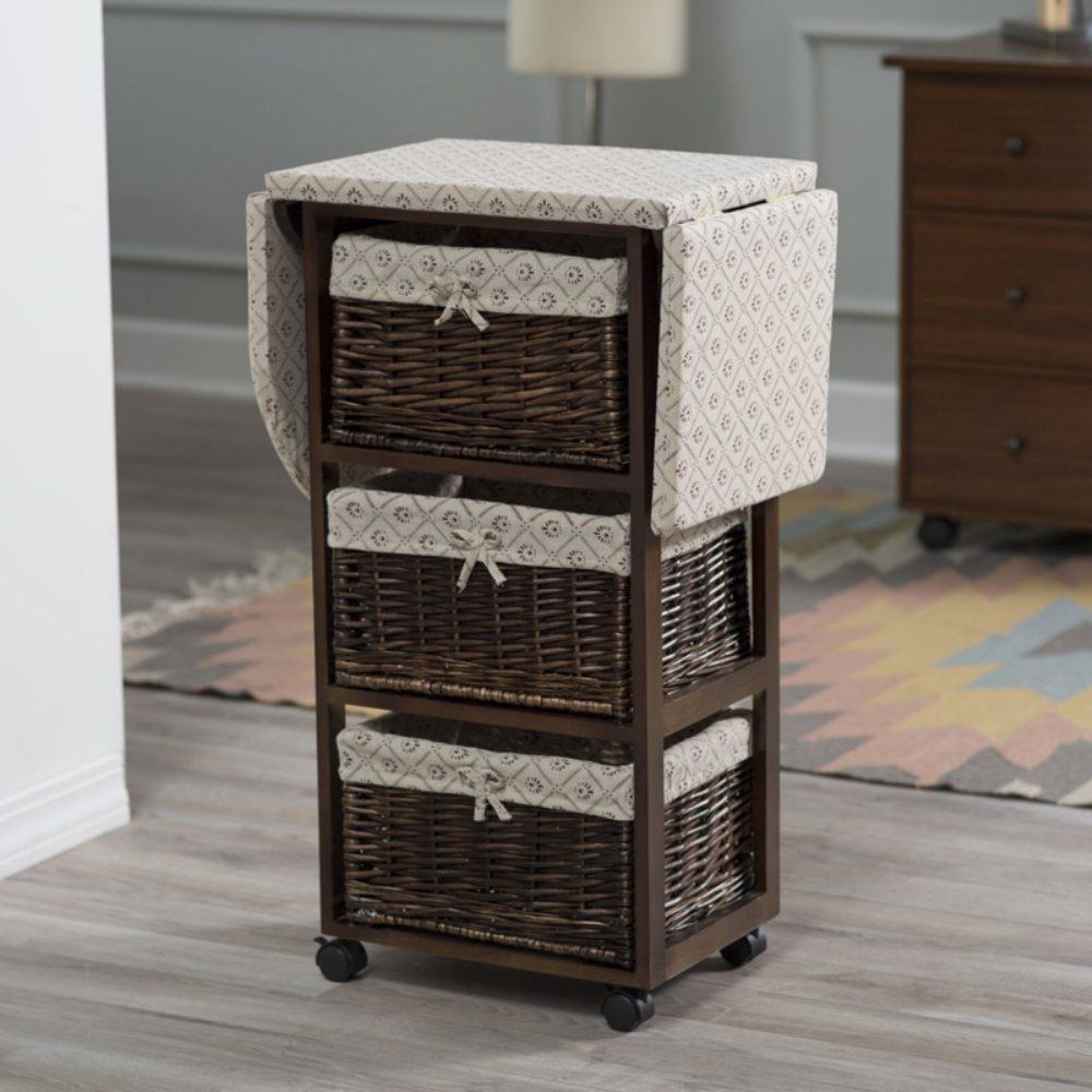 Wood Wicker Ironing Board Center With Baskets Thanks To Its Sy Casters The Can Go Wherever You Do