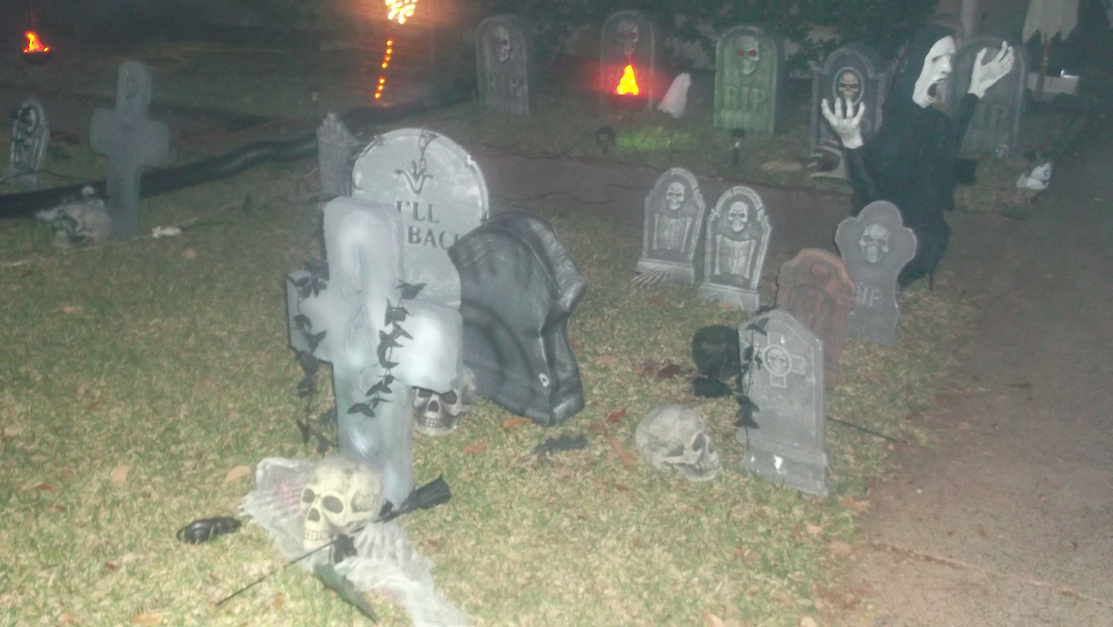 Our cemetery filled with lots of skulls, bones and parts from our local Spirit Halloween store, makes for an awesome cemetery!