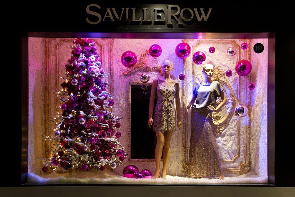 El arte de vestir vitrinas en navidad decoracion for Decoracion para vitrinas