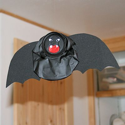Find out how you can easily create a spooky flying bat using an aluminum pop can.