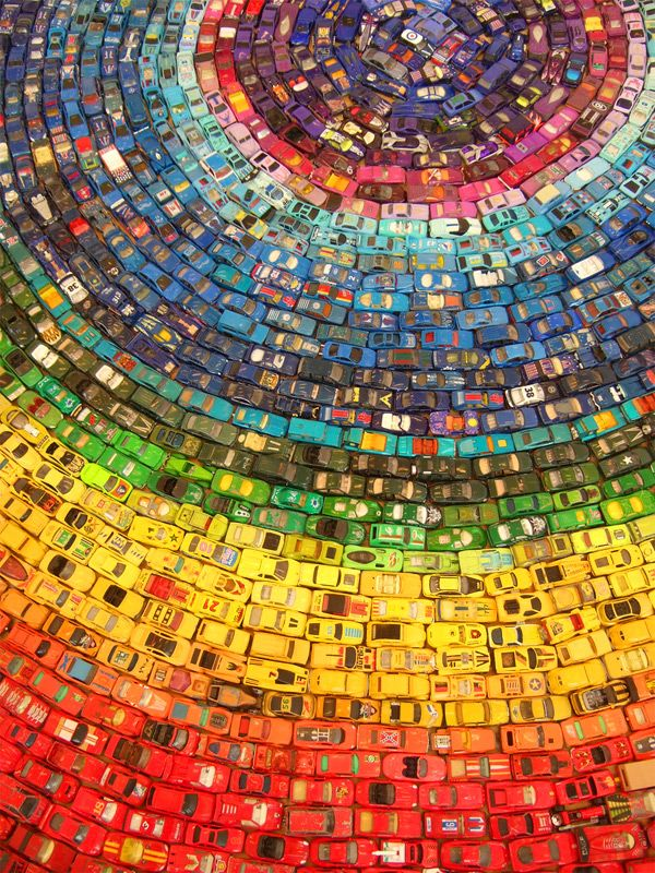 Rainbow Toy Car Installation by David T. Waller: Got wheels! Made from 2,500 toy cars, this installation won the People's Award at the 2010 Arts Depot Open in North London.  via thisiscolossal #Installation #Rainbow_Toy_Cars #David_T_Waller #thisiscolossal