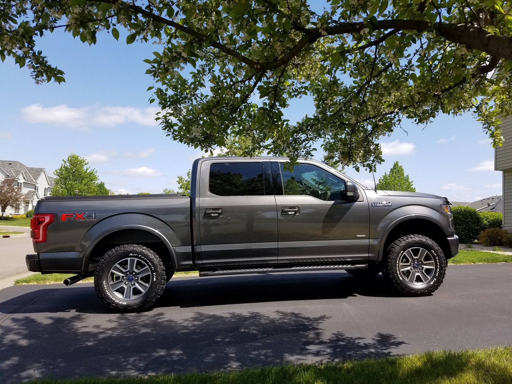 Show me your Leveled trucks with OEM rims! Page 28