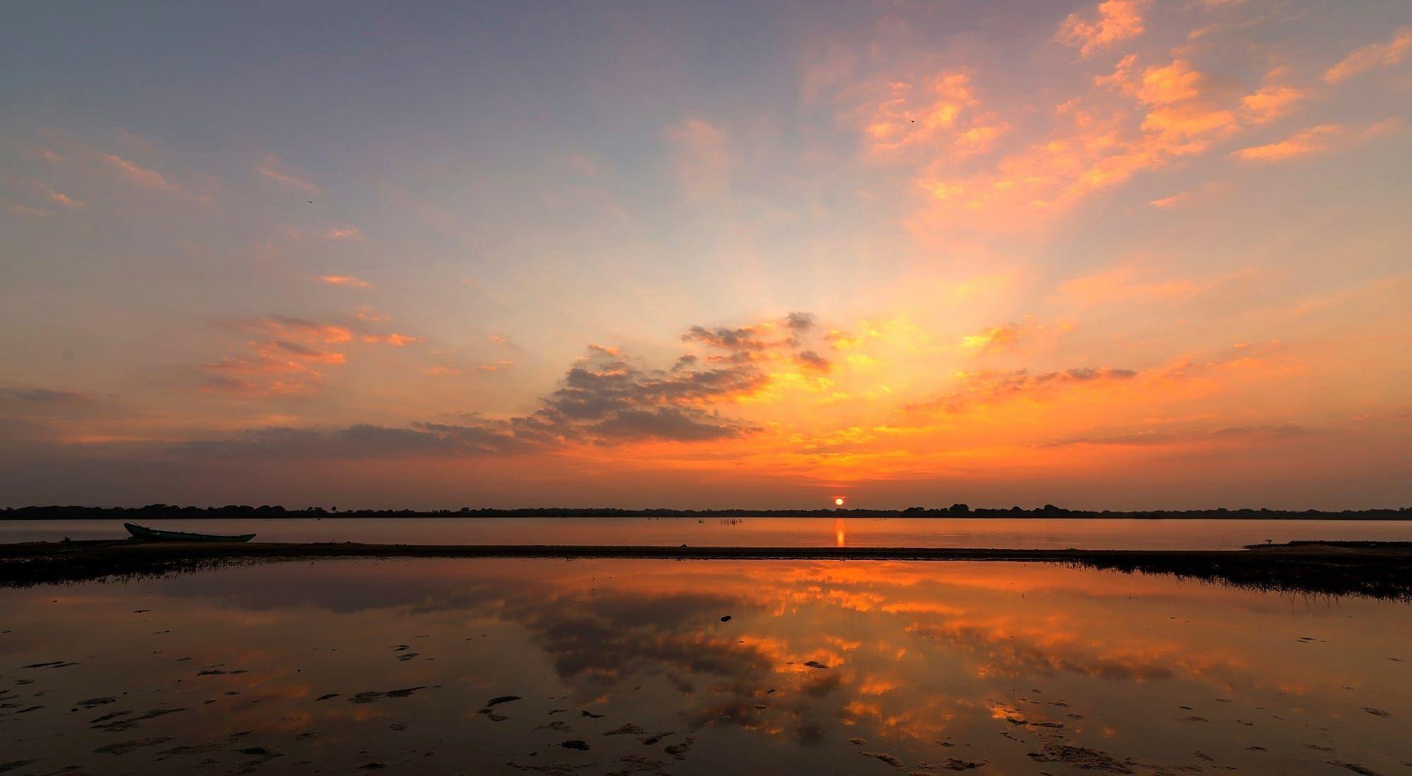 HAPPY NEW YEAR Sunset Over a Lagoon in Nilaveli Sri Lanka ...