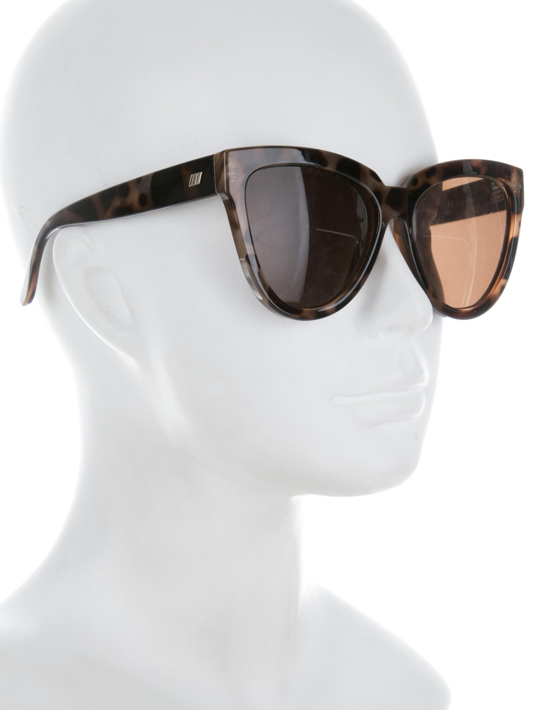 67d7bfa9075da Brown and beige tortoiseshell acetate Le Specs Liar Lair cat-eye sunglasses  with tinted lenses and silver-tone logo accents at temples.