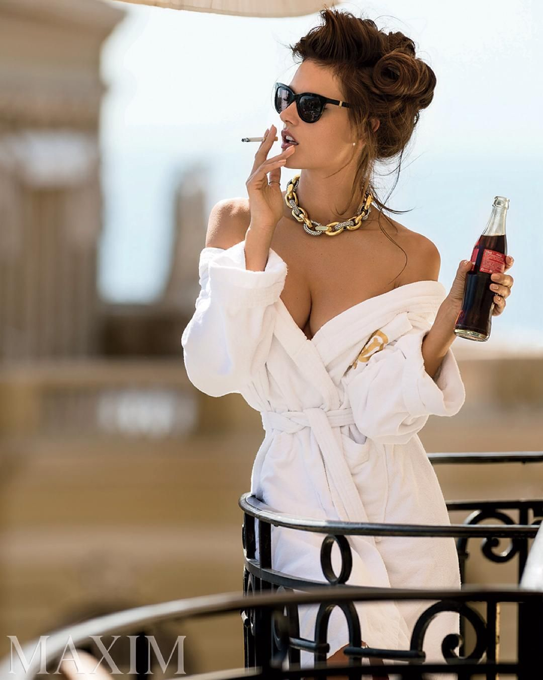 Supermodel Alessandra Ambrosio Sips A Classic Coca Cola While Taking In The Spectacular Views Of