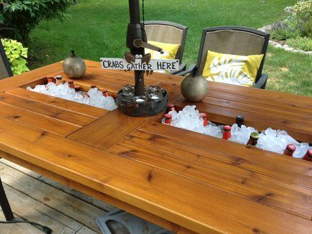 Outdoor cedar table with built in coolers for beer and Picnic table with cooler plans