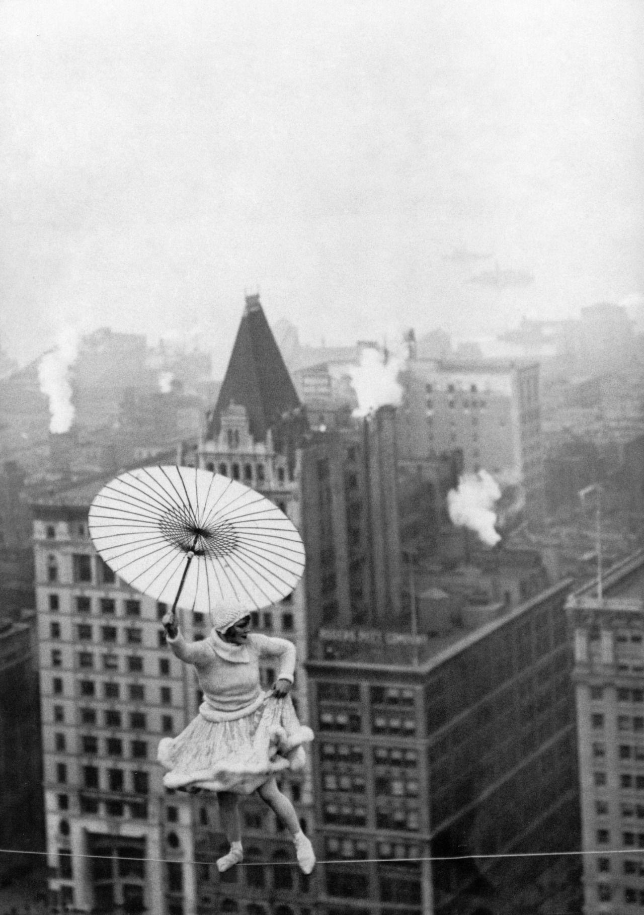 theshinyboogie:  Bird Millman walks wire over Chicago, 1922