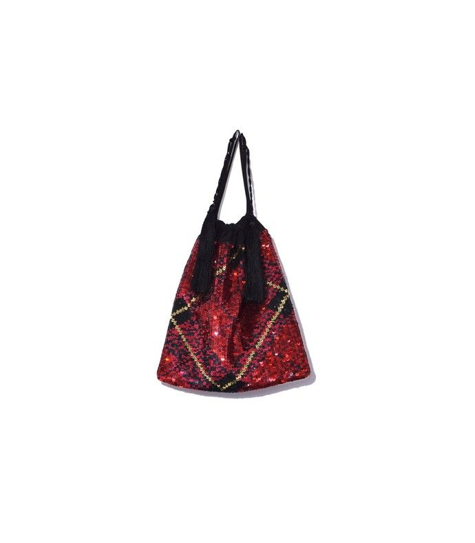 73839747ca90 Red bag featuring a drawstring closure with tassel details. ShopBAZAAR