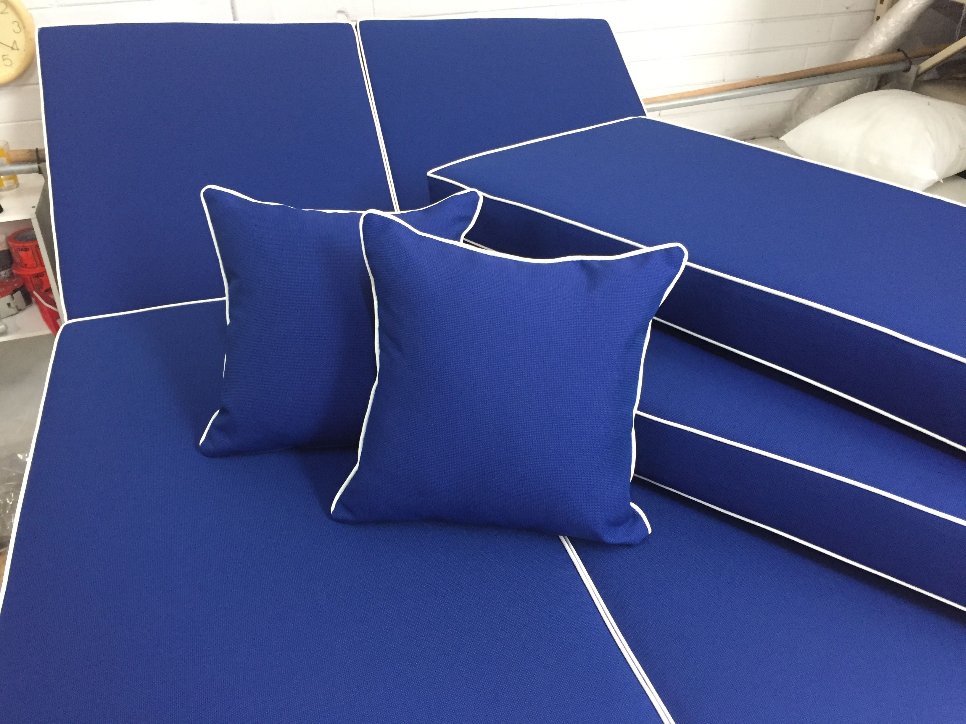 Sunbrella Canvas True Blue with white piping on outdoor