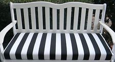 Black And White Dots On Pillows On A Swing Outside | IN / OUTDOOR SWING /