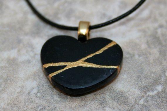 Small broken heart pendant in midnight blue polymer clay
