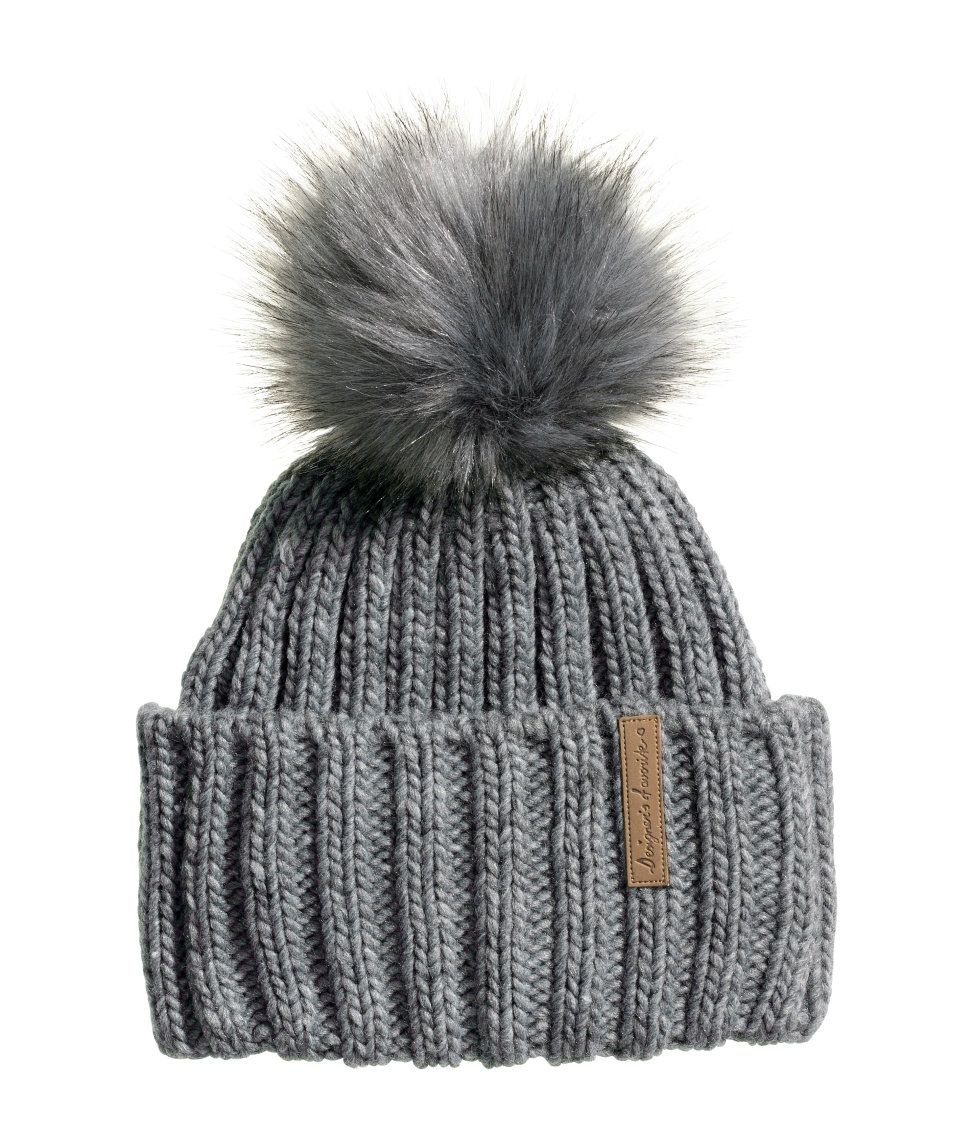 41094edd05e A gray knit hat with faux fur pompom is the perfect finishing touch for a  stylish little one.