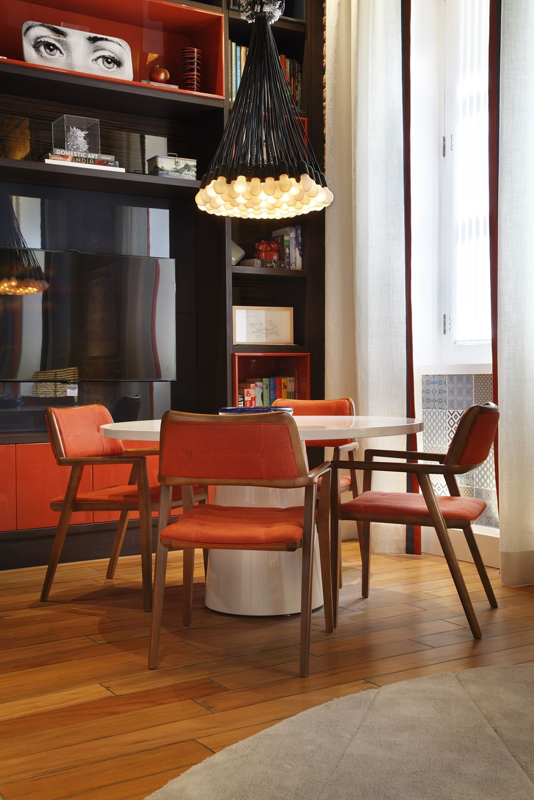 Mid century modern dining room. Great use of orange and black.