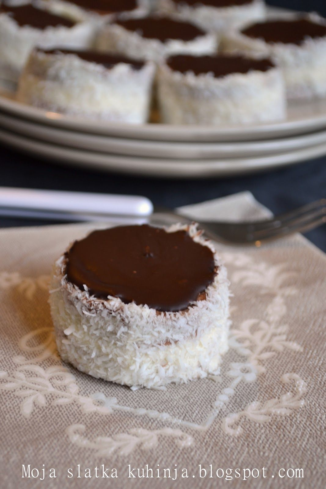 Ruske kape (Trans. Russian Caps) are a type of cake dessert served in ex-Yugoslavia countries, especially in Serbia, Bosnia, and Croatia. It usually comes in a 6-inch-wide, round serving and includes coconut around the edge or sometimes crushed walnuts. The top is usually chocolate drizzled with vanilla. The center includes layers of alternating vanilla, chocolate, and sometimes a mocha flavor.  This dessert comes served chilled,  people eat it like a cupcake with the hands.