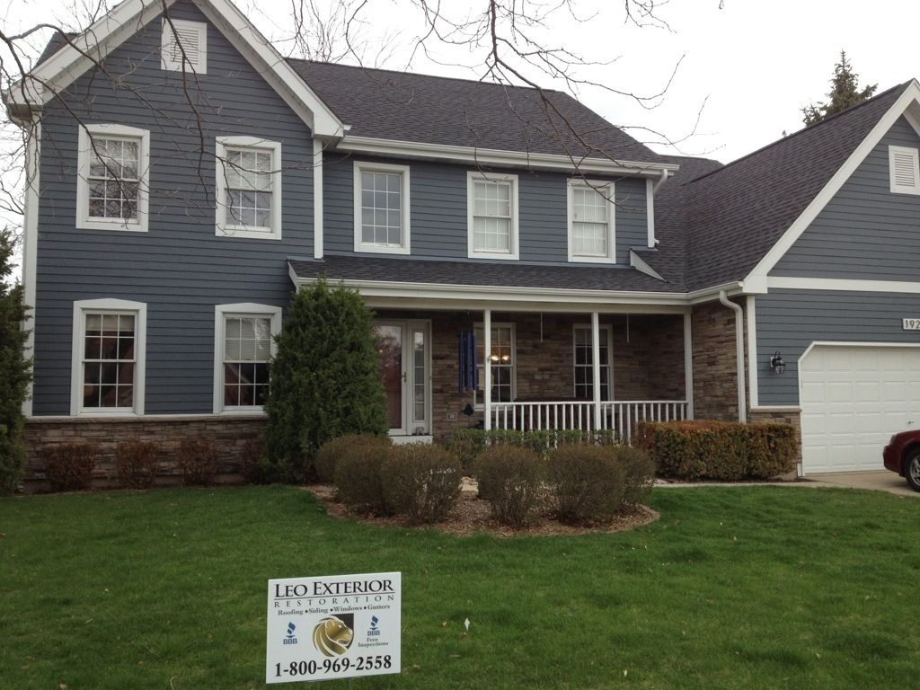 Nice Exterior Home Design With Versetta Stone Gable Roof With Gray Wood Siding And Versetta